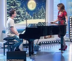 charlie puth uk charlie puth 25 enjoys a flirt with lorraine kelly 57 during tv