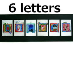 four letter art with 4 letters in medieval illuminated letter