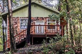 this tiny adorable forest cottage has a sleeping nook tucked into