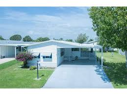 homes for sale in the snug harbor lakes subdivision micco fl