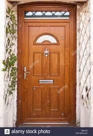 front door with trellis work porch surround uk stock photo