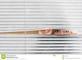 woman looking through venetian blinds stock image image 33838651