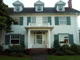 white colonial revival house w green shutters silverton