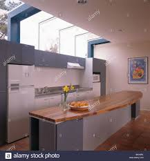 kitchen long island wood worktop on long island unit in modern kitchen extension with