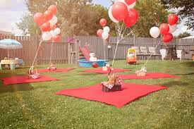Balloons On Sticks Centerpiece by Simple Picnic Party Ideas