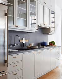 dark grey countertops with white cabinets white cabinets grey countertops metal refrigerator round black