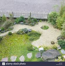aerial view of japanese zen garden with grass and raked gravel