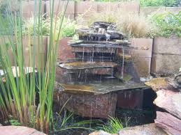 stone waterfall in the middle small ponds backyard garden house