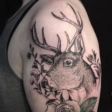 deer in wildflowers by evan davis at banshee tattoo in nashville