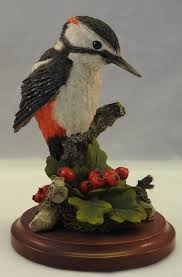 country artists great spotted woodpecker with hawthorne berries in