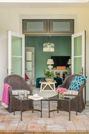french doors open the media room up to a side yard with seating
