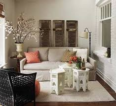 living room with old shutters and moroccan style coffee tables