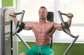 butterfly chest exercise on machine stock photo ibrak 111612192