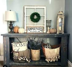 entry way table decor console table decor ideas beach style entry with a console table