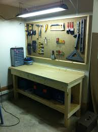 workbench with pegboard and light 47 easy ways to get organized making use of diy pegboard ideas