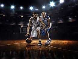 Basketball Courts With Lights Red Basketball Player In Action In Gym Stock Photo Picture And