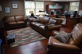 Living Rooms With Dark Brown Leather Furniture Dark Brown Leather Sofa With Rectangle Wooden Table And Two F Lamp