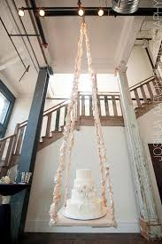 Swing From The Chandelier Trend We Love Gravity Defying Wedding Cakes Bridalguide
