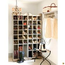 white wooden walk in closet with many racksfor shoe organizer and