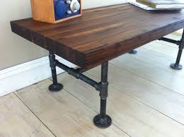 low and large vintage large butcher block work table with black