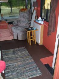 Camper Interior Decorating Ideas by Rv Decorating Ideas With A Dark Carpet And A Small Wooden Table In