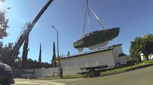 neighbor lifts sailboat out of backyard with crane youtube