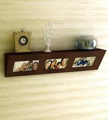 wall shelves pepperfry buy home sparkle brown engineered wood with photo frame wall shelf