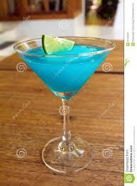 blue raspberry margarita frozen blue margarita cocktail in martini glass royalty free stock