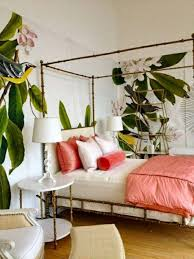 Bed Making Stylish Tropical Bedroom With Fresh Wallpaper And Bamboo Canopy