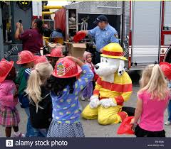 sparky the plays with children during a prevention