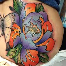 butterflies tattoos on leg colored flowers and butterfly tattoo on back