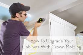 how to add crown molding to the top of your cabinets young house