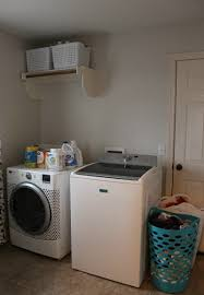 Laundry Room Storage Between Washer And Dryer by Laundry Room Makeover For Under 100