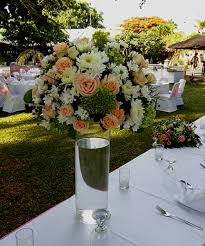 mix flower centerpiece in glass vases bali vintage florist