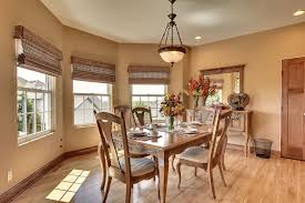 traditional dining room with hardwood floors u0026 pendant light in