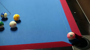 Felt Pool Table by Game Of Pool With Blue Felt Pool Table Sinking Black Ball In