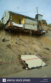 sea erosion to cliffs at hemsby norfolk england cause bungalow