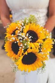 wedding flowers sunflowers navy yellow sunflowers brewery wedding brewery wedding