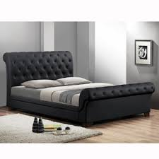 baxton studio leighlin black modern sleigh bed with upholstered