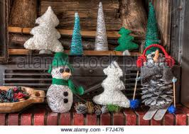 Some Christmas Decorations - a horizontal frontal view of a decorated fireplace with some stock