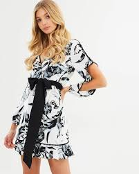 Shoptagr Ariana Draped Wrap Dress By Atmos U0026here