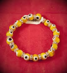 red bracelet with eye images Evil eye bracelet yellow 4mm hex old world witchery jpg