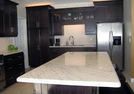 what color granite with white cabinets and dark wood floors white granite dark cabinets png