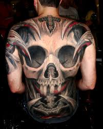 tribal skull back tattoos tattoo ideas center