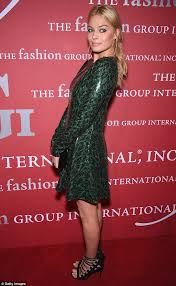 margot robbie shows off her slim figure in a sequin dress daily