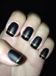 black matte french nail design with gold glitter line for the fall