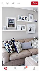 Decorating Living Room Wall Decorate Picture Ledge In The Office Picture Ledge Shelves And Living Rooms
