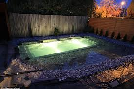 Backyard Swimming Ponds - swiss family spends 34 000 and one year building natural swimming