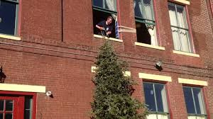 10 step guide throwing a 12 foot christmas tree out a window