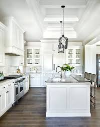 white kitchen island with black granite top all white kitchen subscribed me